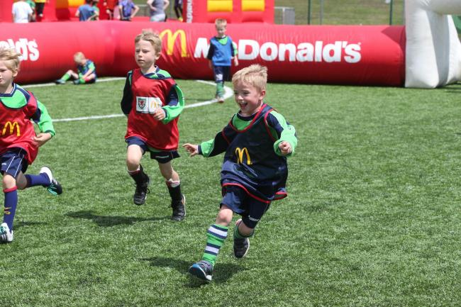 Hundreds of excited children join in FAW Trust and McDonalds community football day